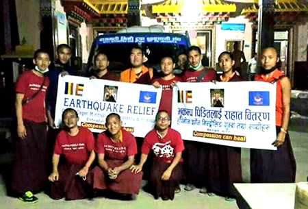 Monks gather for a photo before departing to earthquake area.