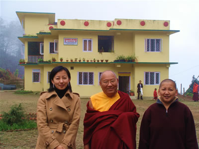 Jetsün Dechen Paldrön, HE Khochhen Rinpoche and Jetsün Khandro Rinpoche in front of the medical clinic at Lava.