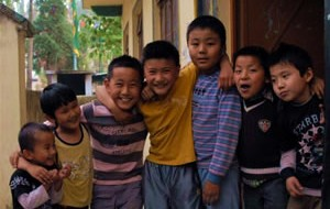 A group of children outside the community hall at Dekyi Ling built with funds provided by STCS