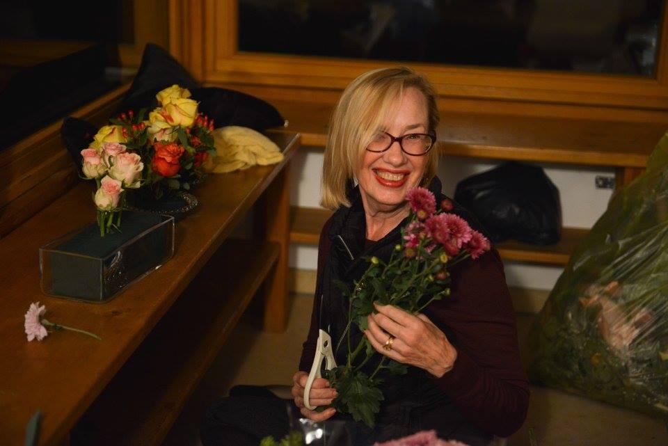 Lopön Barabara Ryan arranging the flowers for the shrine.