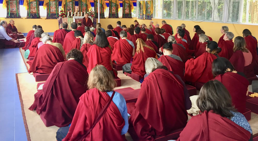 Members of the Western sangha listen to a teaching by HE Jetsün Khandro Rinpoche